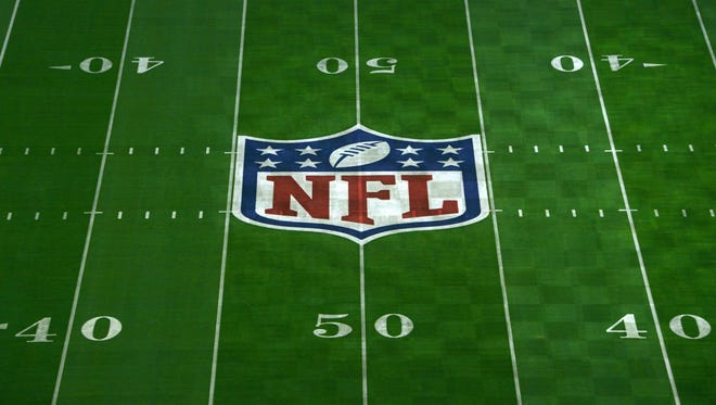General view of NFL shield logo at midfield of University of Phoenix Stadium in advance of Super Bowl XLIX between the Seattle Seahawks and the New England Patriots.