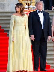 First lady Melania Trump and President Donald Trump watch welcome ceremony at Blenheim Palace, west of London, on July 12, 2018.