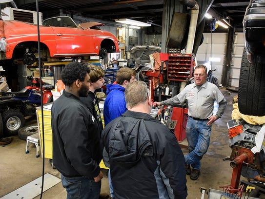 Jeff Hinkemeyer, owner of Glen's Precision Auto, right,