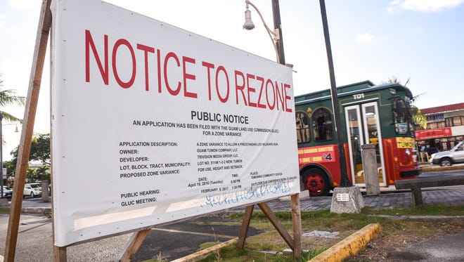 A Notice to Rezone can be seen posted in the parking lot of the Pacific Bay Hotel in Tumon on Monday, June 5, 2017. The signage indicates an application for a zone variance, filed by the Guam Tumon Company with the Guam Land Use Commission, in regards to constructing a freestanding electronic LED billboard at the location along San Vitores Road.