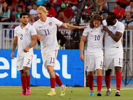 U.S. player Jozy Altidore, right, celebrates with teammates after scoring against Chile during their friendly soccer match in Rancagua, Chile, Wednesday, Jan. 28, 2015. From left are Deandre Yedlin, Brek Shea and Mix Diskerud. (AP Photo/Luis Hidalgo)