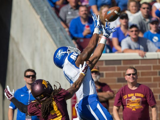 MTSU tight end Lucas Hamilton (88) attempts to catch the ball over Minnesota defensive back Derrick Wells (3) in the second quarter on Saturday, Sept. 6 at TCF Bank Stadium.