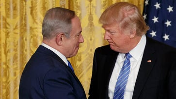 President Trump shakes hands with Israeli Prime Minister Benjamin Netanyahu during a news conference in the East Room of the White House, Wednesday.