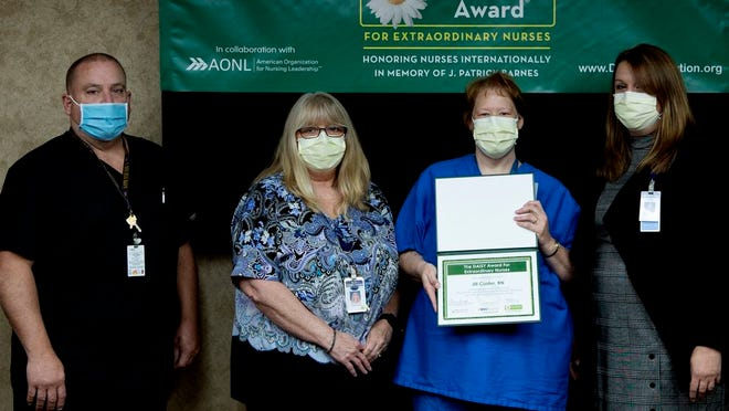 Jill Custer (second from right), DAISY Award recipient at Potomac Valley Hospital, is pictured with Ralph Gumbert, Emergency Department director; Cathy Harmon, Med Surg clinical coordinator; and Elaine Geroski, vice president of nursing.
