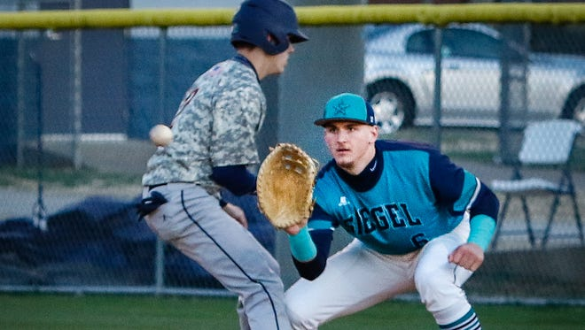 Siegel senior first baseman Zac Pearson takes a pickoff throw during a recent game. Pearson, an MTSU signee, hasn't pitched for the Stars because of elbow problems.