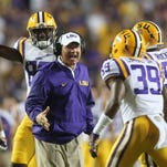 LSU Tigers head coach Les Miles congratulates Russell Gage (39) after a tackle against the Jacksonville State Gamecocks during the second half at Tiger Stadium. LSU defeated Jacksonville State 34-13.