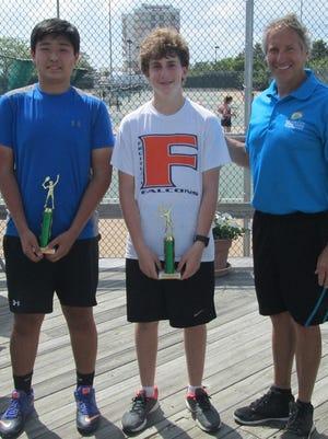 Tournament Director Bruzz Truitt poses with James M. Bennett's Zeth Weaver (first place, Silver Flight) and Alex Kim (second place, Silver Flight) at the Ocean City Tennis Center.