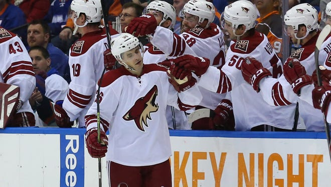 Arizona Coyotes center Mark Arcobello high fives this teammates during the game against the New York Islanders.