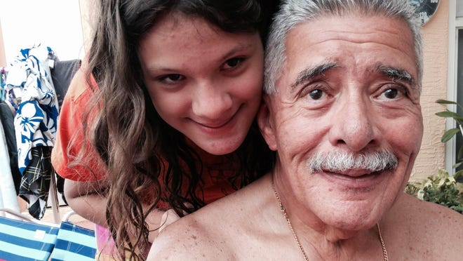 John's daughter Isabelle mugs with his dad, Rico while on vacation.