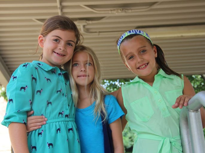 Elizabeth Max, Katie Rose Robinson and Allie Mouch spend time hanging out at recess on the first day of third-grade at Hilltop School.