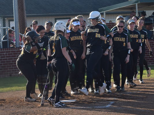 Menard's Jensen Howell (20) is greeted by teammates at home plate after hitting a home run against Ouachita Saturday.