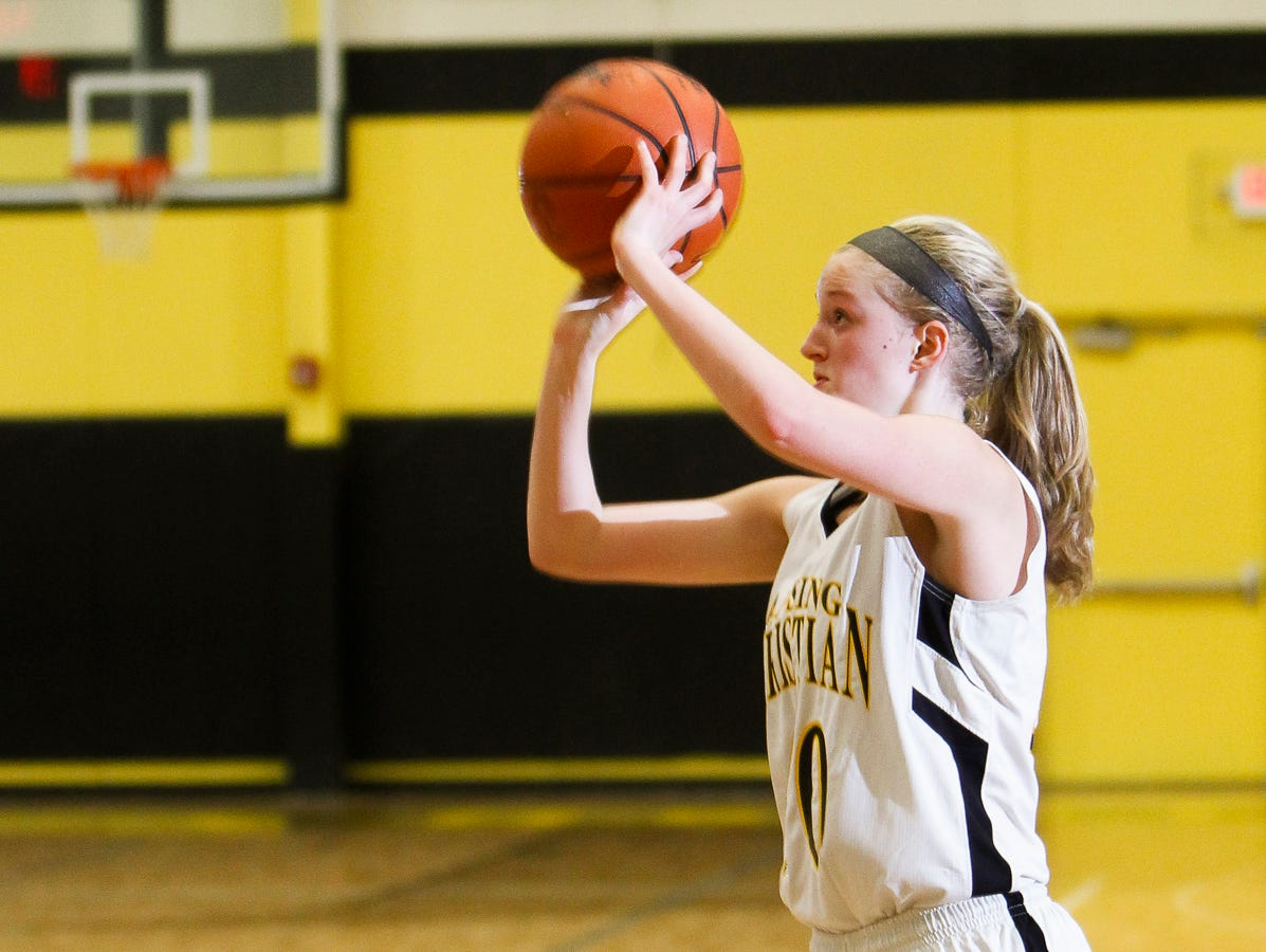 Lansing Christian's Grace Haley shoots from three-point land against Carson City December 16, 2014, at Lansing Christian.