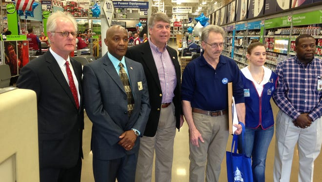 From left: Bart Swift, Larry Simmons, State Sen. Ed Jackson, Johnny McCoy, Lowe's Store Manager Stephanie Roeman and Reginald Sims.