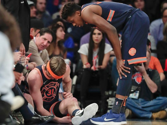 New York Knicks guard Ron Baker (31) sits on the sideline