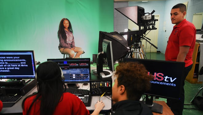 Manchester Regional High School students Dyandra Brown, background, and Michael Pagan, right, producing a video Feb. 16 in their school TV studio.