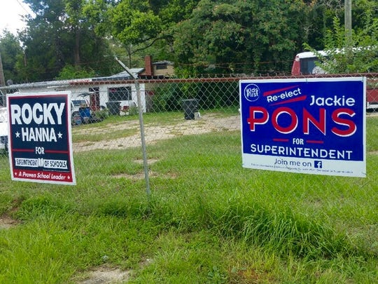 Dueling signs prompted a Tallahassee woman to post a live video Thursday on Facebook.