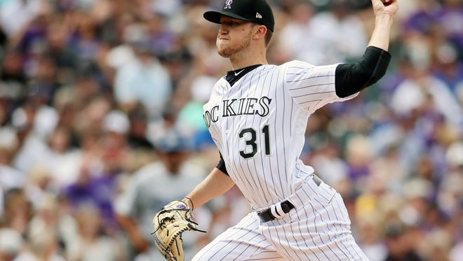 Apr 7, 2017; Denver, CO, USA; Colorado Rockies starting pitcher Kyle Freeland (31) delivers a pitch during the first inning against the Los Angeles Dodgers at Coors Field. Mandatory Credit: Chris Humphreys-USA TODAY Sports