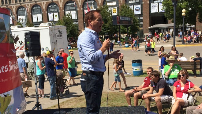 Republican secretary of state candidate Paul Pate speaks on the Des Moines Register Political Soapbox at the Iowa State Fair