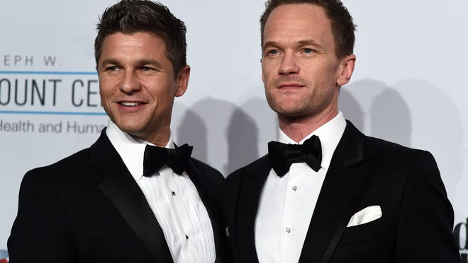 David Burtka (L) and Neil Patrick Harris arrive to attend the Elton John AIDS Foundation's 13th Annual An Enduring Vision Benefit on October 28, 2014 in New York. AFP PHOTO/Jewel SamadJEWEL SAMAD/AFP/Getty Images ORIG FILE ID: 534832198