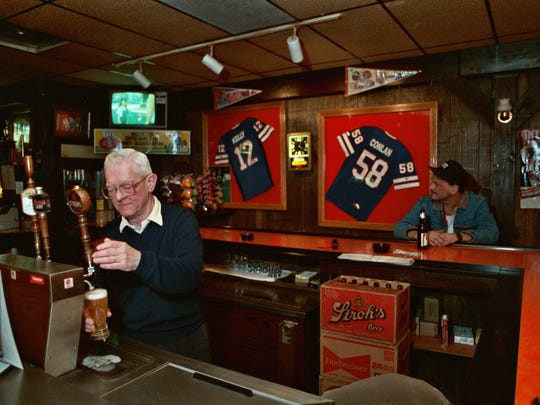 Art Vasbinder draws a beer at Bachelor's II, Kelly's hangout whenever he returns home.