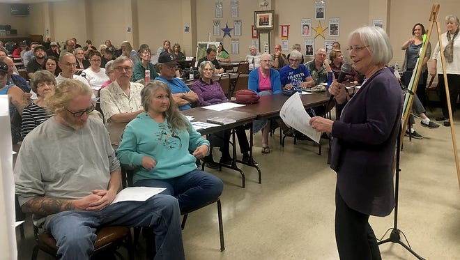 Kitsap County Commissioner Charlotte Garrido speaks to more than 250 people who packed the Port Orchard Eagles hall to discuss a proposed tiny cottage village at Port Orchard Church of Christ on Salmonberry Road.