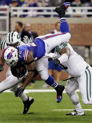 Buffalo Bills running back Anthony Dixon is upended by New York Jets defensive end Sheldon Richardson during the first half on Monday, Nov. 24, 2014.