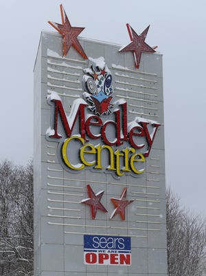 A Sears sign is affixed to an entrance sign to Medley Centre in Irondequoit in this January 2016 photo.