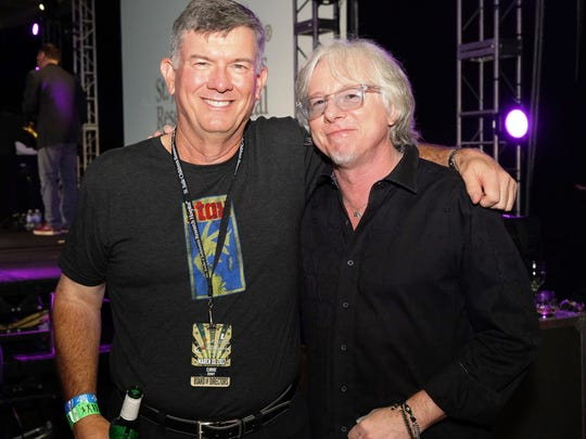 Tournament chairman, Clarke Rheney, with longtime participant of The Warburton and Rock and Roll Hall-of-Famer, Mike Mills, the bassist for REM.