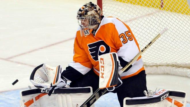 Philadelphia Flyers goalie Steve Mason makes a save against the Edmonton Oilers this month.