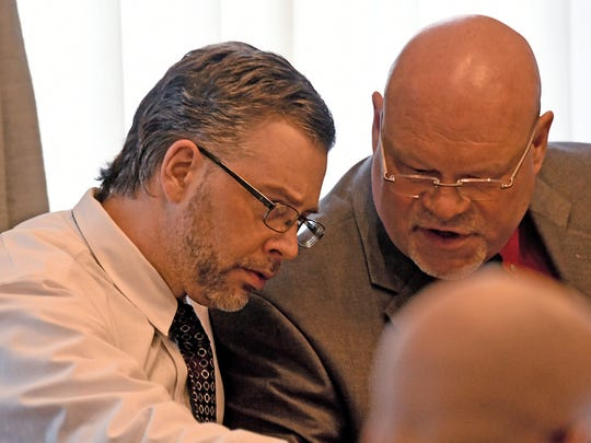Shawn Grate listens to his attorney, Rolf Whitney, during jury selection Wednesday morning.
