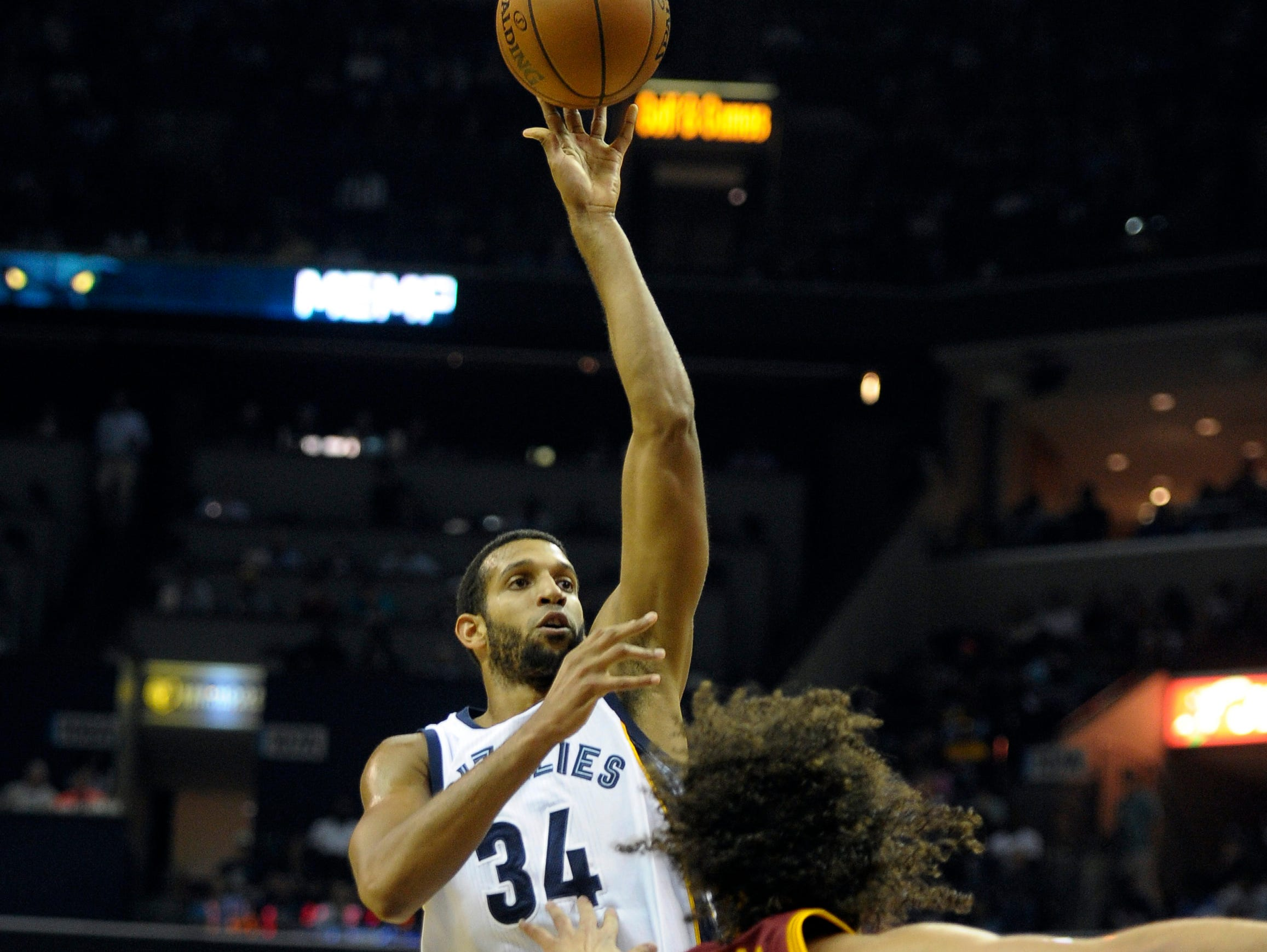 Memphis Grizzlies forward Brandan Wright (34) shoots over Cleveland Cavaliers forward Anderson Varejao (17) in Wednesday's opener.