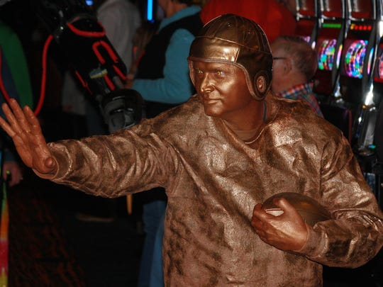 Robert Shangle from Sparta dressed up as The Heisman Trophy during Firekeepers Casino's Annual Costume Contest in 2015.