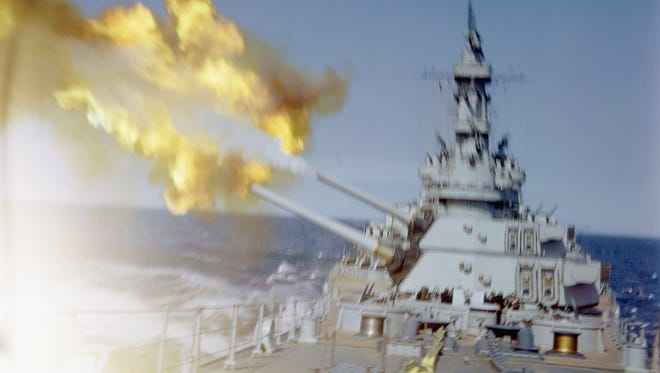 U.S. cruiser fires her main batteries at Japanese positions on the southern tip of Okinawa, Japan in 1945. (AP Photo)