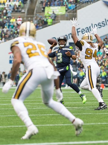 Sep 22, 2019; Seattle, WA, USA; Seattle Seahawks quarterback Russell Wilson (3) passes the ball to wide receiver Tyler Lockett (not pictured) for a touchdown against the New Orleans Saints during the first half at CenturyLink Field. Mandatory Credit: Steven Bisig-USA TODAY Sports