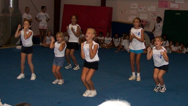 Cheer campers performing for friends and family at the Vero Beach Recreation Department's Spring Break Cheer Camp.