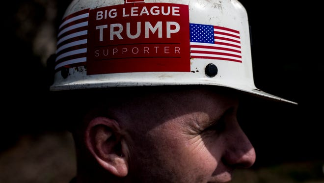 Kentucky coal miner Paul Miracle waits in line before the arrival of President Donald Trump to the Kentucky Exposition Center's Freedom Hall during the presidential campaign last year.