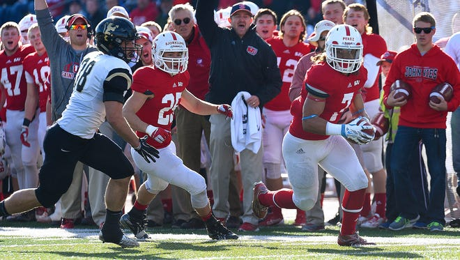 St. John's University's Randy Perez carries the ball during Saturday's game against St. Olaf at Clemens Stadium in Collegeville.