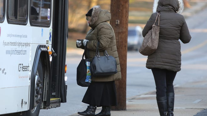 Cincinnati needs to invest in better mass transit, a Cincinnati State student says. Here, two women board a Metro bus in Mount Washington in cooler weather.