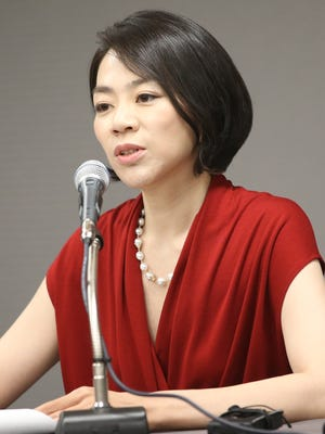 In this Sept. 2014 photo, Cho Hyun-ah, Korean Air's vice president responsible for cabin service and the oldest child of Korean Air chairman Cho Yang-ho, answers reporters' question during a news conference in Incheon, west of Seoul, South Korea. Korean Air Lines apologized Tuesday, Dec. 9, 2014,  for inconveniencing passengers after Cho ordered a crew member off a flight for serving bagged nuts in the first class cabin. (AP Photo/Yonhap) KOREA OUT