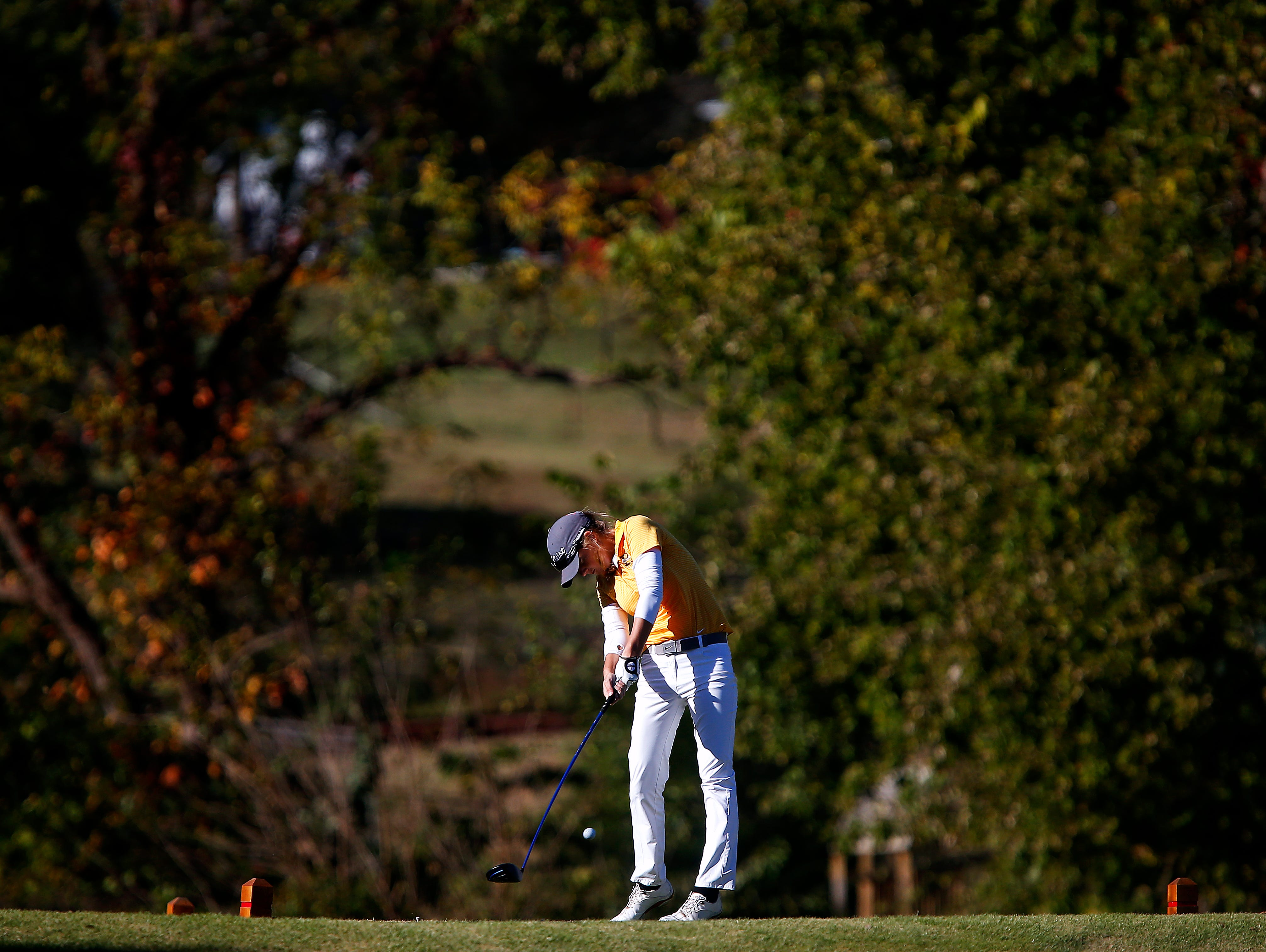 Kickapoo High School golfer Ari Acuff tees off from the 18th hole during the 2015 MSHSAA Class 2 Girls Golf State Championship played at Rivercut Golf Club in Springfield, Mo. on Oct. 13, 2015.