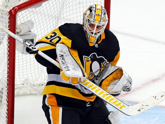 Pittsburgh Penguins goaltender Matt Murray blocks a shot during the third period of an NHL hockey game against the Montreal Canadiens in Pittsburgh, Saturday, March 31, 2018. The Penguins won 5-2 to clinch a berth in the upcoming NHL playoffs. (AP Photo/Gene J. Puskar)