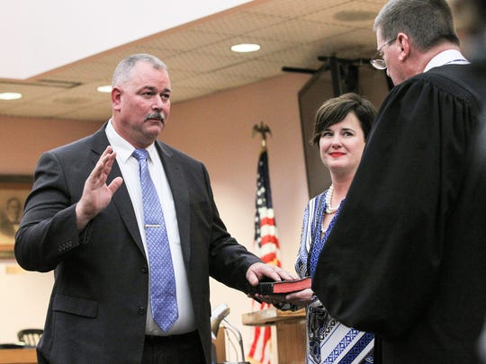 David Wagner, left, is sworn in as the 10th Judicial Circuit solicitor by Judge Cordell Maddox, right, with his wife Melanie Wagner standing by his side on Wednesday at the Anderson County Courthouse.