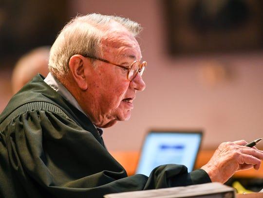 Tenth Circuit Judge Alex Macaulay speaks to John Wesley