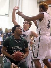 Spackenkill's Kyiev Bennermon is double teamed in the