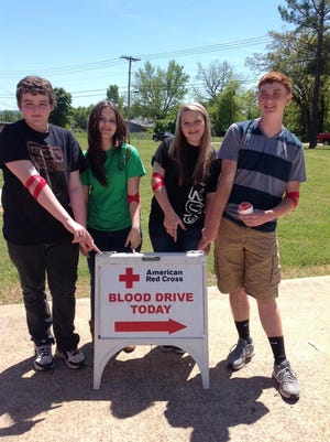 Flippin High School students, from left, Hunter Skill, Kaitlyn Pendergrass, Jordan Wallace and Leland Campbell are shown with a blood drive sign. All are regular donors to the American Red Cross. A Flippin High School Student Council blood drive for the American Red Cross Blood Drive is set for 8:30 a.m.-1:30 p.m. Sept. 25 on the Flippin Middle School parking lot. Community members are urged to donate.