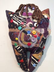 "Barbara Tyson Mosley's dolls consist of mixed media and are part of Kore Gallery's exhibit ""Three Women of Art."""