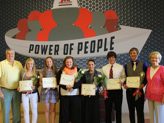 Seven students received scholarships from the Michels Corporation Scholarship Fund, Inc., Tuesday, for the 2015-2016 academic year. Recipients are children of current Michels employees. From left are Pat Michels, President, Michels Corporation; Aja Buss; Cassandra Wessing; Courtney Renderman; Ashley Nehls; Taylor Ramthun; Chad Wolf-Flash; and Ruth Michels, Chairman of the Board. Hannah Pederson is not pictured.