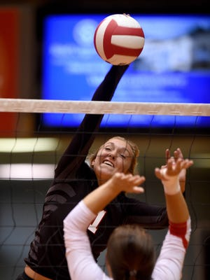 Richmond's Lauren Pierce hits against Union County's Cassidy Krom Tuesday, Sept. 6, 2016, during a volleyball match in the Tiernan Center at Richmond.