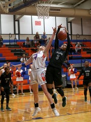 Central's Cadye Nelms struggles against a player from