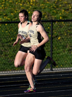 Nicole Bryant, left, and Cassidi Bookless turn the first corner during the 400, as River View rolled to a team title in the Wayne Clark Invitational at Zanesville's John D. Sulsberger Memorial Stadium earlier this season. Bookless highlights several River View athletes competing in the Division II regional meet at Muskingum University.